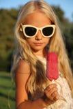 niña y helado Fotos de archivo