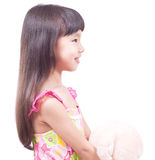 Niña y oso rosado del juguete Fotografía de archivo