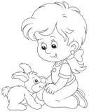 Niña y su pequeño conejo Fotos de archivo