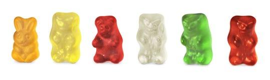 Niñez y caramelos de los osos de la jalea aislados encendido foto de archivo libre de regalías
