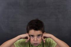 Niño aburrido en la escuela Foto de archivo libre de regalías