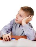 Niño aburrido que hace la preparación Imagen de archivo libre de regalías