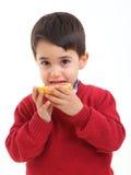 Niño adorable con un pomelo Imagen de archivo