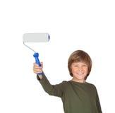 Niño adorable con un rodillo de pintura Imágenes de archivo libres de regalías