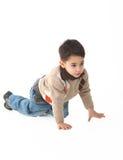 Niño adorable en estudio que recorre encendido Fotografía de archivo libre de regalías