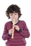 Niño adorable que toca la flauta Imágenes de archivo libres de regalías