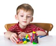 Niño agradable con plasticine Foto de archivo libre de regalías