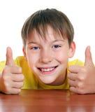 Niño alegre con el pulgar para arriba Imagen de archivo libre de regalías