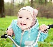 Niño alegre en la bici de los niños Fotografía de archivo