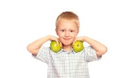 Niño que come la comida sana Foto de archivo libre de regalías