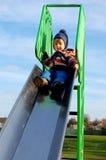 Niño alto para arriba en la diapositiva Foto de archivo libre de regalías