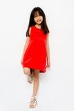 Niño asiático con el vestido rojo Fotografía de archivo