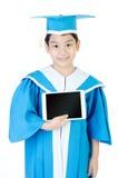 Niño asiático con la tableta Fotografía de archivo