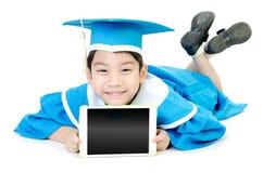 Niño asiático con la tableta Fotografía de archivo libre de regalías