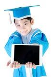 Niño asiático con la tableta Foto de archivo libre de regalías