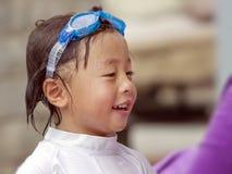 Niño asiático después de nadar Imagen de archivo libre de regalías