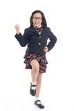 Niño asiático en uniforme escolar con el bolso de escuela rosado Fotografía de archivo