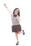 Niño asiático en uniforme escolar con el bolso de escuela rosado Foto de archivo libre de regalías