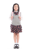 Niño asiático en uniforme escolar con el bolso de escuela rosado encendido Foto de archivo libre de regalías