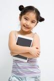 Niño asiático feliz con la tableta Imagen de archivo libre de regalías