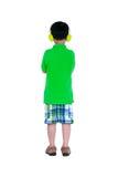 Niño asiático feliz con los auriculares, aislados en el fondo blanco Foto de archivo libre de regalías