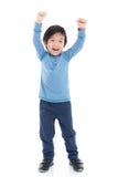 Niño asiático que muestra sig del ganador fotos de archivo