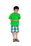 Niño asiático que sufre del dolor de estómago sobre la imagen - una cita del presidente John F Fotografía de archivo libre de regalías
