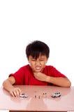 Niño bajo meditación Fotos de archivo libres de regalías