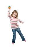Niño bonito que juega una pequeña bola Imagen de archivo libre de regalías