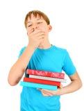 Niño cansado con libros Imagen de archivo libre de regalías