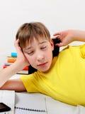 Niño cansado con libros Imagen de archivo