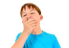Niño cansado que bosteza Foto de archivo