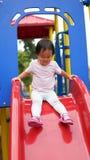 Niño chino asiático en el top de la diapositiva Imagen de archivo