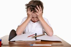 Niño con dificultad de aprendizaje Imágenes de archivo libres de regalías