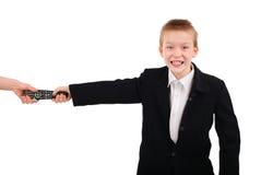 Niño con el aparato de TV teledirigido Fotografía de archivo libre de regalías