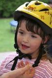 Niño con el casco de la bicicleta Fotos de archivo libres de regalías