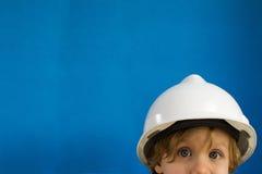 Niño con el casco protector Foto de archivo libre de regalías