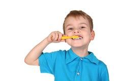 Niño con el cepillo de dientes fotos de archivo libres de regalías