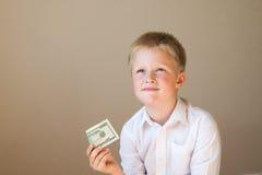 Niño con el dinero (20 dólares) Fotografía de archivo libre de regalías