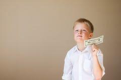 Niño con el dinero (20 dólares) Fotos de archivo