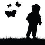 Niño con el ejemplo de la mariposa en naturaleza Fotografía de archivo libre de regalías