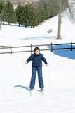 Niño con el esquí de fondo Imagen de archivo libre de regalías