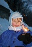 Niño con el fuego artificial fotos de archivo libres de regalías