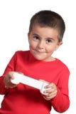Niño con el juego de video teledirigido Foto de archivo libre de regalías