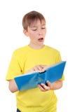Niño con el libro Foto de archivo libre de regalías