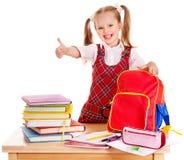 Niño con el libro de la pila. Fotografía de archivo libre de regalías