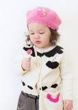 Niño con el Lollipop Imagenes de archivo