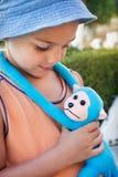 Niño con el mono del juguete Imagen de archivo