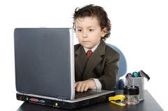 Niño con el ordenador Foto de archivo