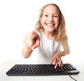 Niño con el ordenador Fotos de archivo libres de regalías